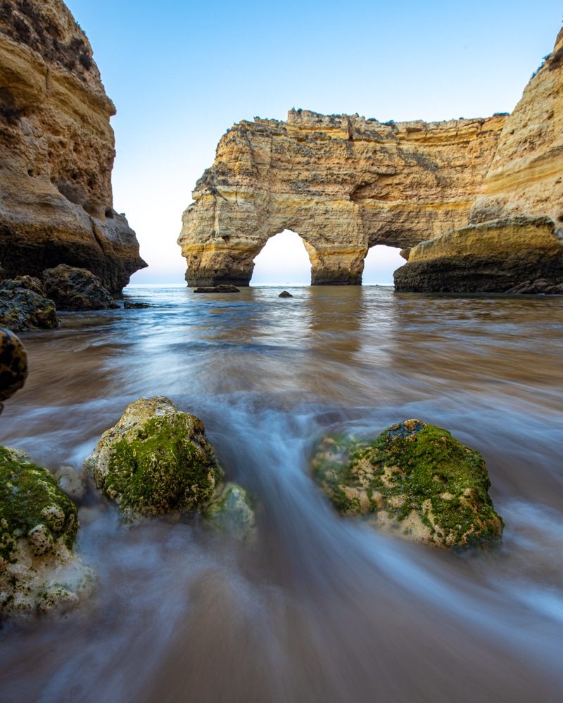 The arches at praia da marinha in the algarve. Rocks in the foreground.